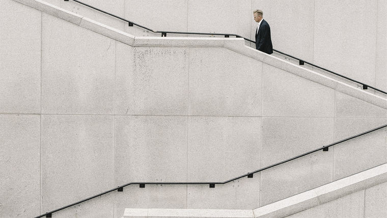 Brand-Led Culture: CEO walking up stairs